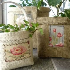 Burlap Clay Pot Covers - these are SO cute! Can be made sturdier to use without the pot inside too. Basic overview and materials list - pattern is not free, but I love this idea! Sewing Pattern | Crafts | YouCanMakeThis.com #burlap #flowerpot #cachepot #applique #crafts #sewing tå√