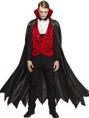 """I vant to suck your blood!"" Sink your teeth into Halloween with the Vampire Costume. This Halloween fancy dress costume includes a waistcoat, cape and cravat."