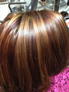 Brown red, red violet lowlights and  blonde highlights