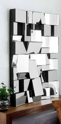 Bring light and interest to your wall with this fascinating piece of wall art. Constructed from a series of angled blocks of mirror, it can be mounted in portrait or landscape to spread light in every direction.