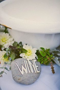 You can't get more DIY than stealing from the earth for your décor! Paint pebbles or rocks to bring a bit of nature to your table as a personal accent.Related:25 DIY Wedding Centerpieces (That Don't Look Homemade)