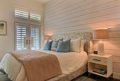 beach house bedroom with shiplap wall