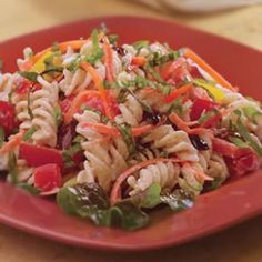 Garden Pasta Salad  This lightly dressed pasta salad gets lots of flavor from kalamata olives and basil. A colorful mix of diced bell pepper, shredded carrot and tomatoes adds vitamins and minerals. Serve on a crisp bed of greens. Toss in canned chunk light tuna, cooked chicken or flavored baked tofu to add protein and make it more substantial.