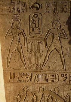 Union between Upper and Lower Egypt and cartouche of Pharaoh, relief on base of thrones,Temple of Ramesses II,Abu Simbel.