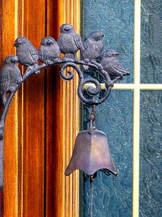 I like bells on back doors.  These are cute ones.  I have a simpler one now but would trade for this.