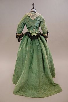 1870s green, cream and black lace