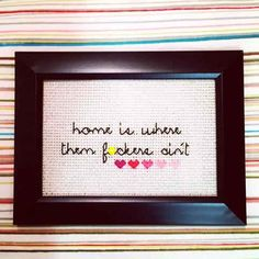 This framed cross-stitch to welcome you home after a day of being around people: