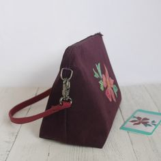 This wide-based bag is made from upcycled fabric in a deep plum colour and features my appliqued clematis design in pink and green. Plum Colour, Color, Floral Fabric, Cotton Fabric, Clematis Flower, Belt Bags, Luxury Bags, Pink And Green, Shopping Bag