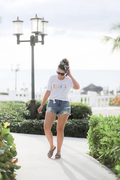Travel Outfit for a Tropical Getaway Royal Bahamian, Ocho Rios, Layering Outfits, Hair Ties, Wedding Anniversary, Short Hair Styles, Graphic Tees, Tropical, Budget