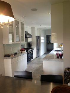 All white kitchen.  Carrera counter tops. White Lacquer cabinets.