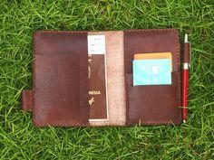 Passport Case Wallet Organizer With 2 Passport Slot 1 Ticket Slot 2 Card Slot 1 Hidden Slot 1 Pen Slot( for Locking) http://shopee.co.id/androwin/92249766