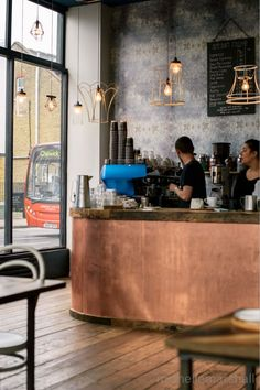 Copper bar cladding and chunky top at Artisan coffee, London