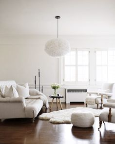 all white living room with wood floors. / sfgirlbybay