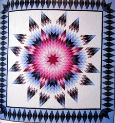 Radiant Star quilt from the book, Shining Star Quilts: Lone Star Variations by…