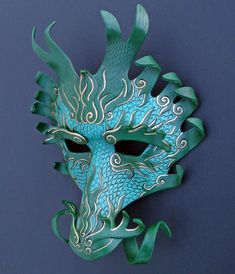 Possibly with foam core (see So Crafty board http://pinterest.com/pin/213217363578312270/ for How To...  Ancient Dragon Mask by merimask.deviantart.com)