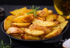 Ruddy Baked potato wedges with rosemary and garlic on a dark background. Ruddy Baked potato wedges with rosemary and garlic on a dark background. Tempura, Empanadas, Potato Wedges Baked, Baked Potato, Chicken Wings, Sweet Potato, Diet Recipes, Sausage, Garlic