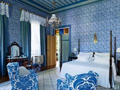 In this Sig Bergamin–designed São Paulo home, artist Nathalie Morhange hand-painted the walls of the master suite. A blue Romo fabric curtains the windows, the bed is dressed in Victoria Mill embroidered linens, and club chairs covered in a Stroheim print are placed on an Arraiolos carpet.