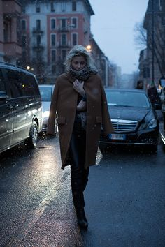 The Sartorialist.  via Fogazzaro, Milan.  (This is how you dress for weather with grace).