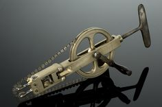 Victorian: Skull Saw (1830s-60s)  This hand-cranked saw's blades were used to cut through sections of the skull, allowing for access by other instruments