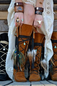 Boho chic long crochet sweater jacket with modern hippie suede boots with fringe and feathers.