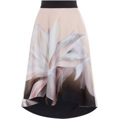 VINA PRINT SKIRT (£129) ❤ liked on Polyvore featuring skirts, mullet skirts, flare skirts, holiday skirts, short front long back skirt and patterned skirts
