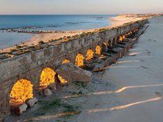 Sun shines through Roman Aqueduct in Cesarea-Israel