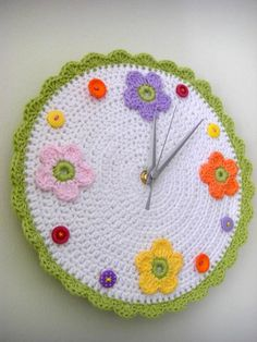 multi colored crochet clock    This would be so cute in my Grandaughters bedroom <3 I would use number buttons .....