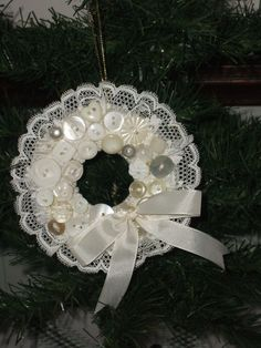 Hand stitched felt wreath decorated with gathered lace and buttons.