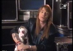 Axl Rose presenting the TV documentary about the band Queen called Days Of Our Lives.
