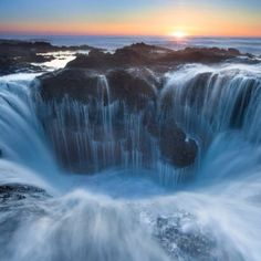 "Thor's Well a/k/a ""the gates of the dungeon"" on  Cape Perpetua, Oregon . At moderate tide and strong surf, flowing water creates a fantastic landscape"