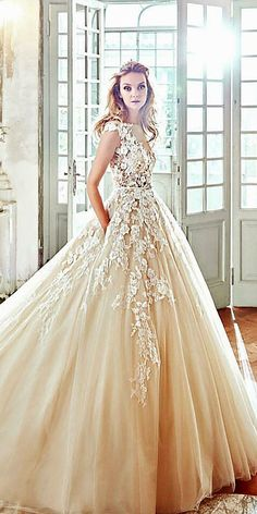 24 Gorgeous Floral Applique Wedding Dresses - Trend For 2016 ❤ They are not only fine, they are also in trend for this year. See more: http://www.weddingforward.com/floral-applique-wedding-dresses/ #wedding #dresses