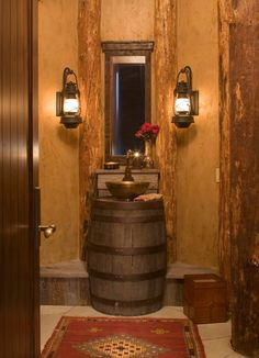 Warm Rustic Powder Room Design Ideas with Classic Mirror Style, upcycled Old Wooden Beer Barrel, and Brass Bowl Sink.