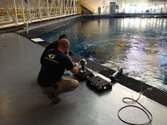 The team working on finalizing the 360 cam equipment, before it goes to the bottom of the exhibit.