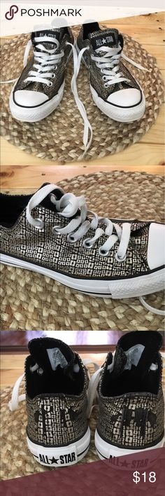 Converse Women's 6.5 Converse Women's 6.5 low top metallic silver scales. Used in good condition. Some visible wear on the back of shoes. please see pics. These are really cute and funky shoes if you're looking for something different! Converse Shoes Sneakers