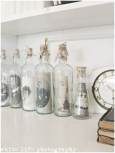 Old photos displayed in bottles.