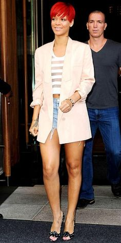 Look of the Day › August 15, 2010 WHAT SHE WORE Rihanna took an N.Y.C. stroll in a Stella McCartney boyfriend blazer over a sheer striped tee and denim cutoffs; she accessorized with a silver bangle and Brian Atwood peep-toes.