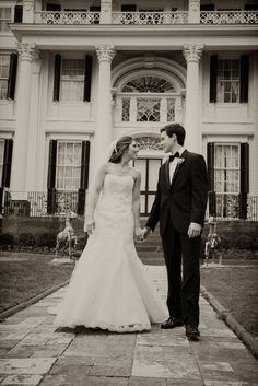 A classic shot with bride & groom in front of Linden Place Mansion's facade. Photo By Snap! Photography