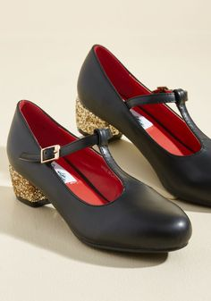 There's something in the way these faux-leather heels move that makes your heart skip a beat! It could be their rich black hue, or maybe the way their golden glitter heels catch the light - whatever it is, this pretty pair has your heart!