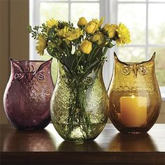 """Our vintage-inspired pressed-glass decorative vases are perfectly sized for a small arrangement of fresh or dried flowers. You can even place a votive in the bottom to create an attention-getting light source for a table setting or mantel. Decorative glass vases in eggplant, green, amber. 8¼""""H x 6"""" diameter. Dishwasher safe."""