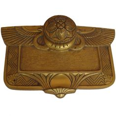 """A Gilt Bronze Desk Inkwell by Maurice Frecourt, 1920.  A well carved gilt bronze inkwell with stylized wings and geometric patterns topped by a floret.   Maurice Frecourt was born in 1890 near Paris; A sculptor, he was the pupil of Valton and Boucher. He exhibited his works at """"Le Salon des Artistes Français"""" from 1920.  Photography provided by DRAKE of Palisades, NY."""