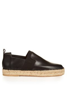 Balenciaga brings contemporary luxury to the classic espadrille by contrasting smooth black leather with a natural-jute braided sole. A wide black elasticated panel allows them to be easily slipped on.   Available at MATCHESFASHION.COM