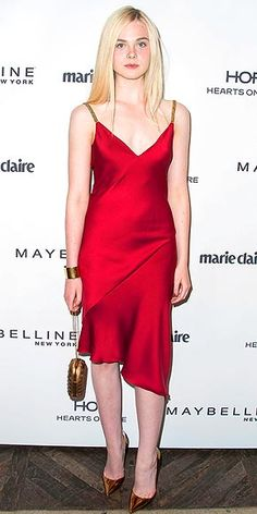 ELLE FANNING Elle looks all grown up! The young actress hits the Marie Claire party in L.A. wearing a deep-red cocktail dress with bronze straps from Versace.
