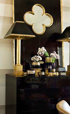 Beth Webb Interiors: Black and gold foyer with glossy black lacquer cabinet with black and gold quatrefoil ...