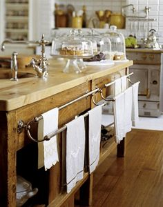 kitchen island, cake platters and dishtowels.