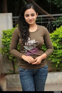 Nithya Menen is an Indian film actress and playback singer. She primarily works in South Indian films, where she has established herself as a leading actress. Beautiful Girl Photo, Beautiful Girl Indian, Most Beautiful Indian Actress, Beautiful Actresses, Beautiful Women, Beautiful Saree, Simply Beautiful, Beauty Full Girl, Beauty Women