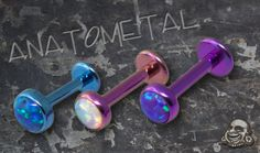 Anatometal from bodyartforms.com: Pre-Order Titanium flatback labret with bezel set cabachon. I want matching ones for all my piercings; so sick of my mismatched earrings now!