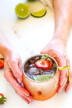 Try this Strawberry Lime Moscow Mule for a twist on the traditional Moscow Mule cocktail. Fresh strawberries, lime juice, vodka and ginger beer combine together in this delicious and refreshing icy cocktail. | platingsandpairings.com