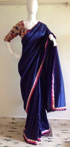 A personal favourite from my Etsy shop https://www.etsy.com/in-en/listing/456527374/deep-blue-semi-silk-saree-with-pom-pom