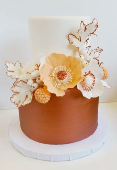 Copper, peach, and white petite wedding cake with detailed gum paste flower and berry spray
