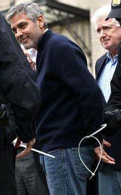 george clooney got arrested at the Sudanese Embassy in Washington. because he took part in a protest for human rights